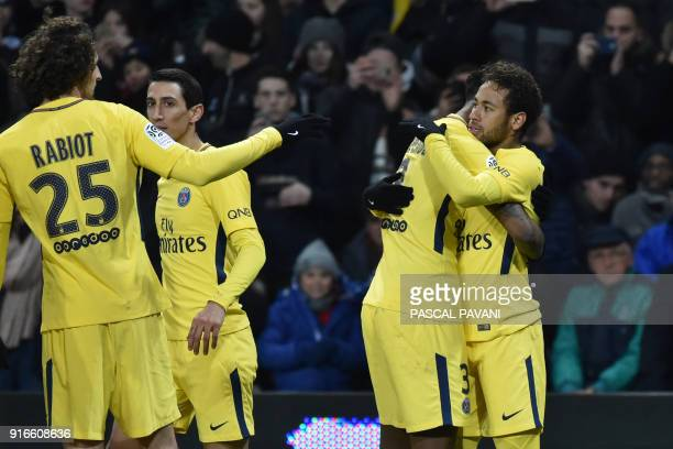 Paris SaintGermain's Brazilian forward Neymar Jr celebrates with Paris SaintGermain's French defender Presnel Kimpembe after opening the scoring as...