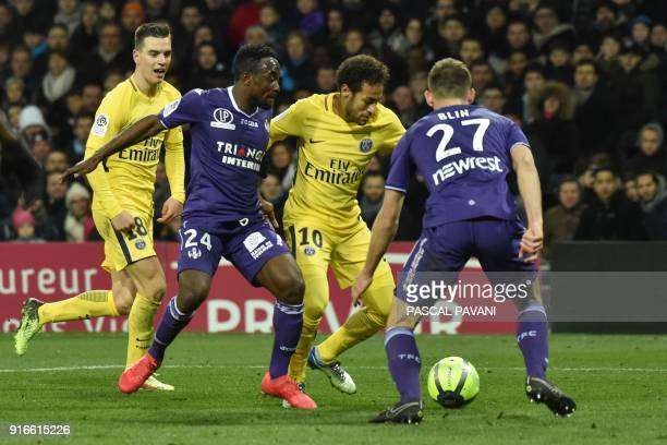Paris SaintGermain's Brazilian forward Neymar Jr dribbles Toulouse' Congolese forward Firmin Mubele and Toulouse's French midfielder Alexis Blin as...
