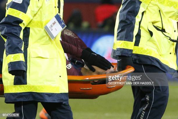 TOPSHOT Paris SaintGermain's Brazilian forward Neymar Jr is evacuated on a stretcher during the French L1 football match between Paris SaintGermain...
