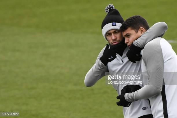 Paris SaintGermain's Brazilian forward Neymar Jr jokes with Paris SaintGermain's Brazilian defender Thiago Silva during a training session at in...