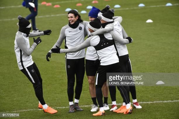 Paris SaintGermain's Brazilian forward Neymar Jr Paris SaintGermain's Uruguayan forward Edinson Cavani and their teammates joke during a training...