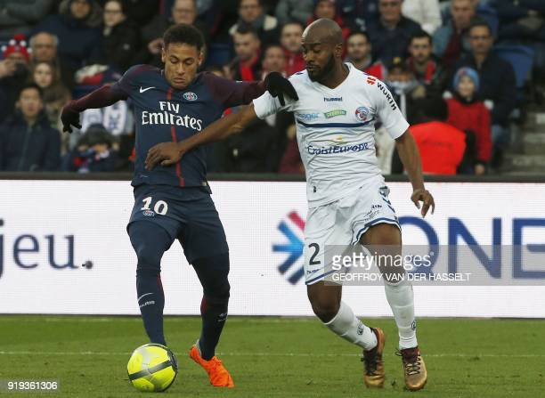 Paris SaintGermain's Brazilian forward Neymar Jr vies with Strasbourg's French defender Dimitri Foulquier during the French Ligue 1 football match...