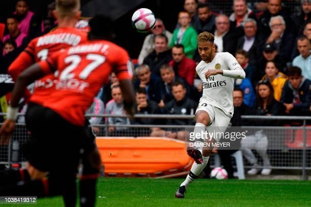 Paris SaintGermain's Brazilian forward Neymar kicks the ball during the French L1 football match between Rennes and Paris SaintGermain at the Roazhon...