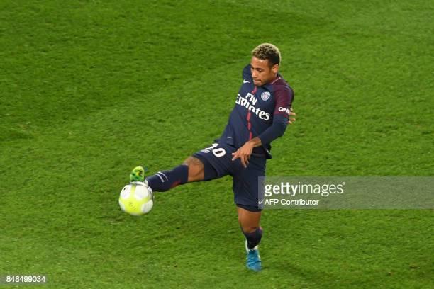 Paris Saint-Germain's Brazilian forward Neymar kicks the ball during the French L1 football match between Paris Saint-Germain and Olympique Lyonnais...