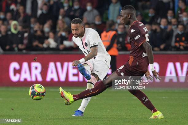 Paris Saint-Germain's Brazilian forward Neymar kicks the ball past Metz's Senegalese midfielder Pape Matar Sarr during the French L1 football match...