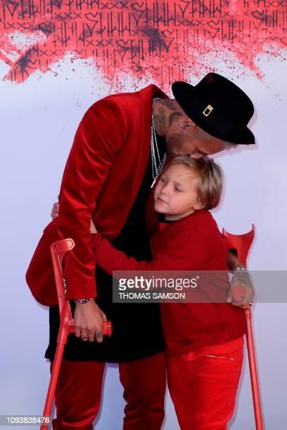 Paris Saint-Germain's Brazilian forward Neymar kisses his son Davi Lucca as he arrives at his birthday party in Paris on February 4, 2019.