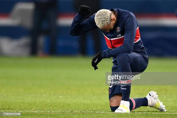 Paris Saint-Germain's Brazilian forward Neymar kneels on the pitch against racism beforethe UEFA Champions League group H football match between...