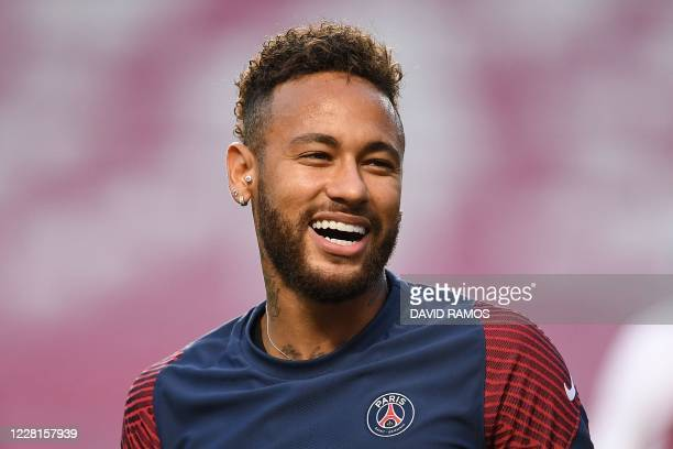 Paris Saint-Germain's Brazilian forward Neymar laughs during a training session at the Luz stadium in Lisbon on August 22, 2020 on the eve of the...