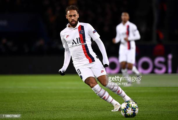 Paris Saint-Germain's Brazilian forward Neymar looks at the ball during the UEFA Champions League Group A football match between Paris Saint-Germain...