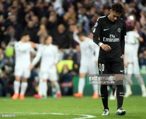 TOPSHOT Paris SaintGermain's Brazilian forward Neymar looks downwards during the UEFA Champions League round of sixteen first leg football match Real...