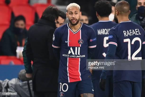 Paris Saint-Germain's Brazilian forward Neymar looks on after the game was suspended amid allegations of racism by one of the match officials during...