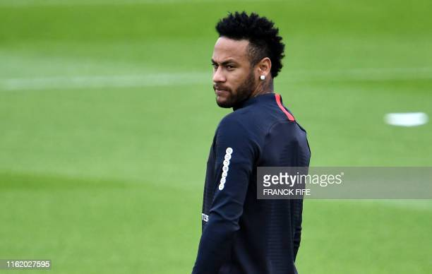 TOPSHOT Paris SaintGermain's Brazilian forward Neymar looks on as he takes part in a training session in SaintGermainenLaye west of Paris on August...