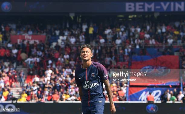 Paris SaintGermain's Brazilian forward Neymar looks on during his presentation to the fans at the Parc des Princes stadium in Paris on August 5 2017...