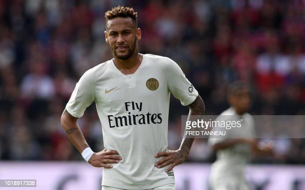 Paris Saint-Germain's Brazilian forward Neymar looks on during the French L1 football match between Guingamp and Paris Saint-Germain, at the...