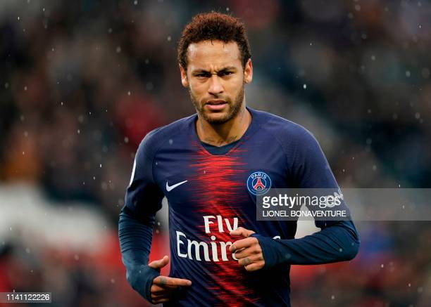Paris SaintGermain's Brazilian forward Neymar looks on during the French L1 football match between Paris SaintGermain and OGC Nice at the Parc des...