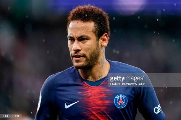 Paris SaintGermain's Brazilian forward Neymar looks on during the French L1 football match between Paris SaintGermain and OGC Nice at the Parc des...