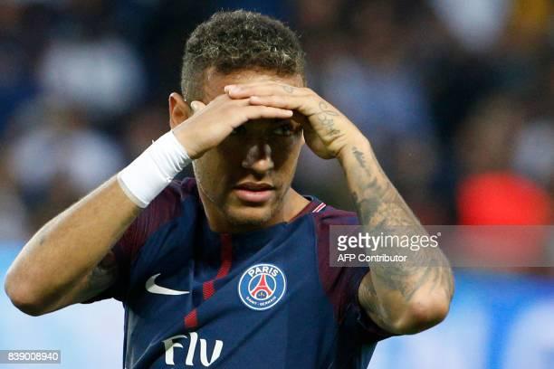 Paris SaintGermain's Brazilian forward Neymar looks on during the French L1 football match between Paris SaintGermain and SaintEtienne on August 25...
