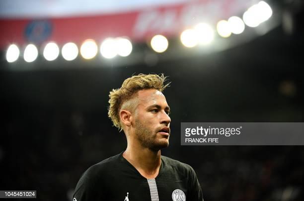 Paris SaintGermain's Brazilian forward Neymar looks on during the UEFA Champions' League football match Paris Saint Germain against Red Star Belgrade...