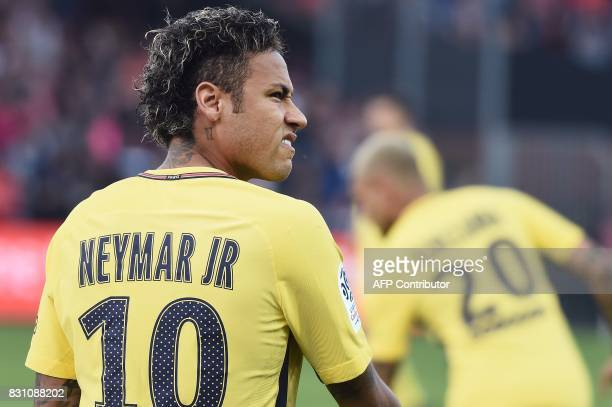 Paris SaintGermain's Brazilian forward Neymar looks on prior to the French L1 football match Paris SaintGermain vs En Avant Guingamp at the Roudourou...