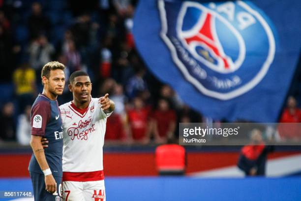 Paris SaintGermain's Brazilian forward Neymar looks on with Bordeaux's Brazilian forward Malcom at the end of the French L1 football match between...