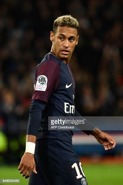Paris SaintGermain's Brazilian forward Neymar looks over during the French L1 football match between Paris SaintGermain and Olympique Lyonnais at the...