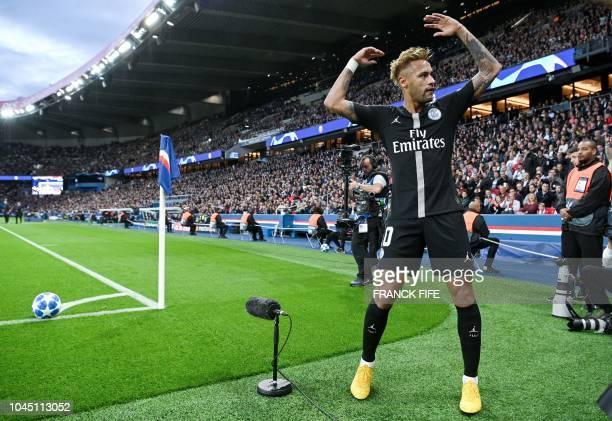 TOPSHOT Paris SaintGermain's Brazilian forward Neymar looks towards the stands during their UEFA Champions' League football match Paris Saint Germain...