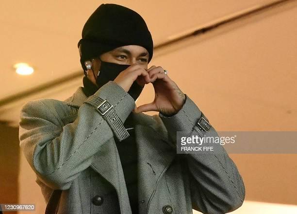 Paris Saint-Germain's Brazilian forward Neymar makes the sign of a heart as he attends the French L1 football match between Paris Saint-Germain and...