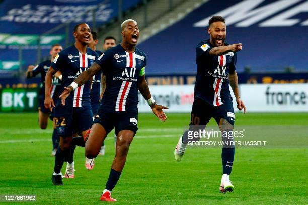 Paris Saint-Germain's Brazilian forward Neymar , Paris Saint-Germain's French defender Presnel Kimpembe and teammates celebrate their victory at the...