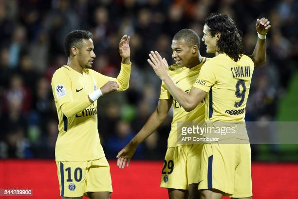 TOPSHOT Paris SaintGermain's Brazilian forward Neymar Paris SaintGermain's French forward Kylian Mbappe and Paris SaintGermain's Uruguayan forward...