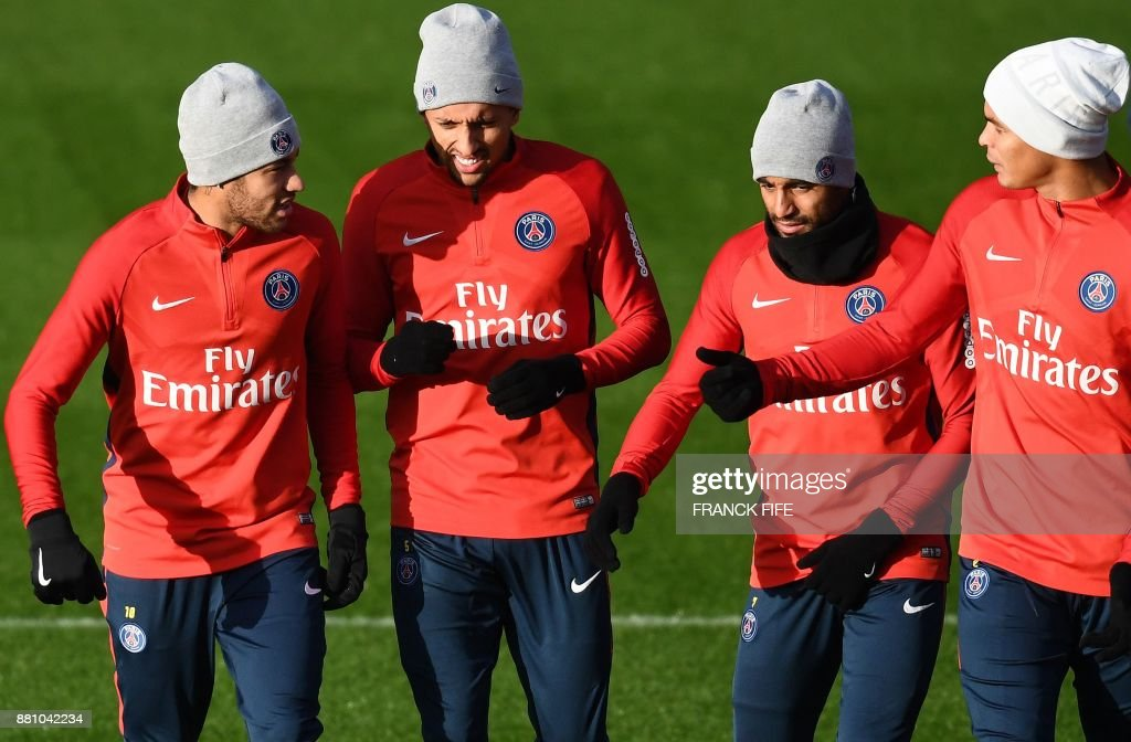 Paris Saint-Germain's Brazilian forward Neymar, Paris Saint-Germain's Brazilian defender Marquinhos, Paris Saint-Germain's Brazilian midfielder Lucas Moura and Paris Saint-Germain's Brazilian defender Thiago Silva attend a training session in Saint-Germain-en-Laye, west of Paris, on November 28, 2017 on the eve of the French L1 football match between Paris Saint-Germain and Troyes. /