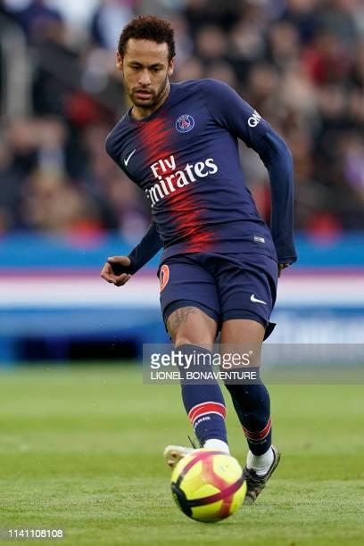 Paris SaintGermain's Brazilian forward Neymar passes the ball during the French L1 football match between Paris SaintGermain and OGC Nice at the Parc...