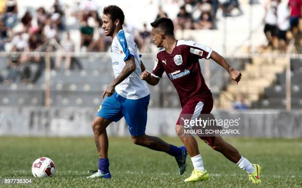 Paris SaintGermain's Brazilian forward Neymar plays during the charity football match 'Ball Hunger Only' at the Jaime Cintra stadium in Jundiai Sao...