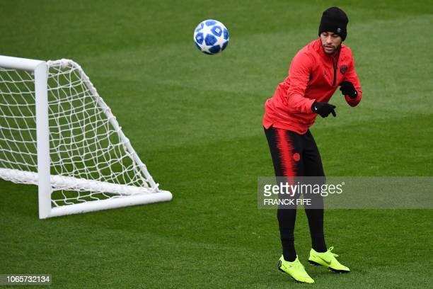 Paris SaintGermain's Brazilian forward Neymar plays the ball during a training session in SaintGermainenLaye west of Paris on November 27 on the eve...