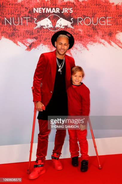 Paris Saint-Germain's Brazilian forward Neymar poses with his son Davi Lucca as he arrives at his birthday party in Paris on February 4, 2019.