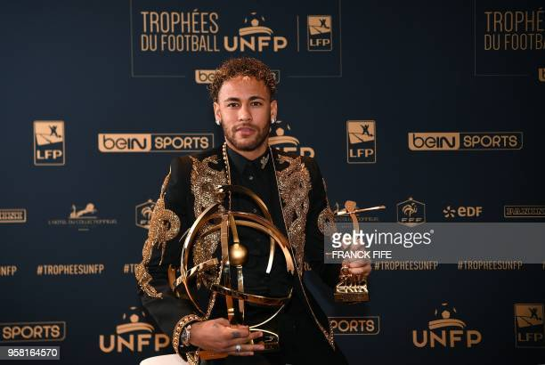 TOPSHOT Paris SaintGermain's Brazilian forward Neymar poses with his trophy after receiving the Best Ligue 1 Player award during a TV show on May 13...