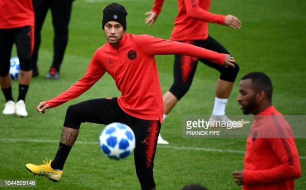 Paris SaintGermain's Brazilian forward Neymar practices during a training session on the eve of the team's Champions League football match against...