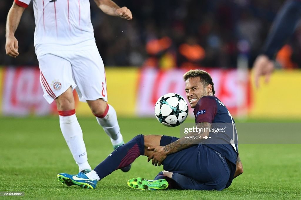 Paris Saint-Germain's Brazilian forward Neymar reacts after a fool during the UEFA Champions League football match between Paris Saint-Germain and Bayern Munich on September 27, 2017 at the Parc des Princes stadium in Paris.