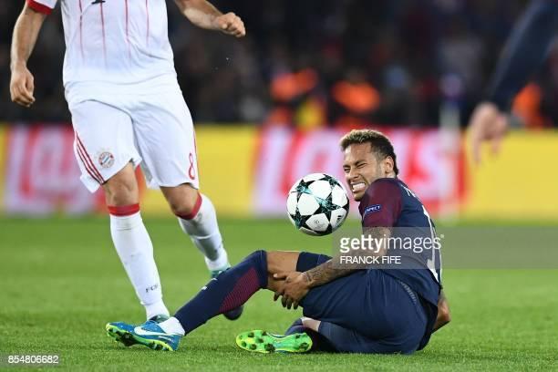 Paris SaintGermain's Brazilian forward Neymar reacts after a fool during the UEFA Champions League football match between Paris SaintGermain and...