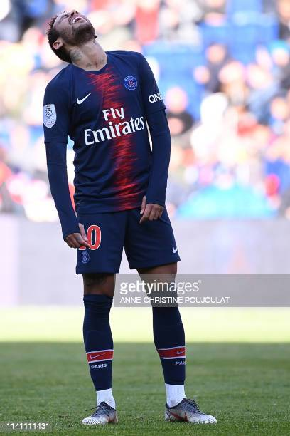 Paris SaintGermain's Brazilian forward Neymar reacts after missing an opportunity to score during the French L1 football match between Paris...