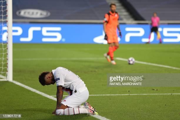 Paris Saint-Germain's Brazilian forward Neymar reacts after missing to score a goal during the UEFA Champions League quarter-final football match...