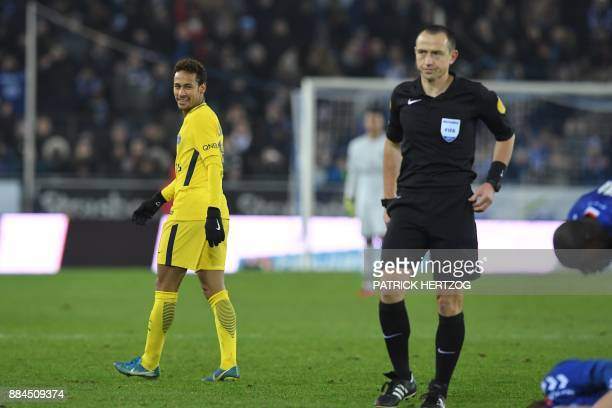 Paris SaintGermain's Brazilian forward Neymar reacts after receving a yellow card from French referee Ruddy Buquet during the French L1 football...