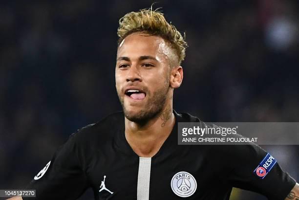 Paris SaintGermain's Brazilian forward Neymar reacts after scoring a goal during their UEFA Champions' League football match Paris Saint Germain...