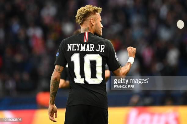 Paris SaintGermain's Brazilian forward Neymar reacts after scoring during their UEFA Champions' League football match Paris Saint Germain against Red...