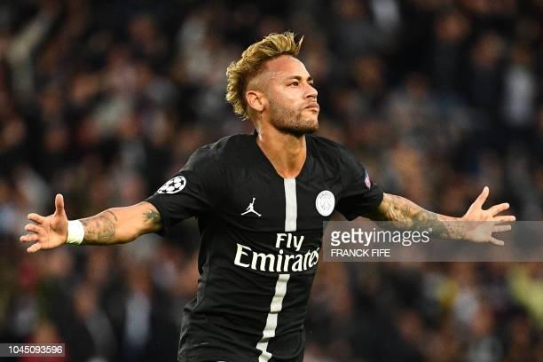 TOPSHOT Paris SaintGermain's Brazilian forward Neymar reacts after scoring during their UEFA Champions' League football match Paris Saint Germain...