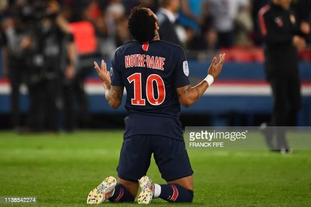 Paris Saint-Germain's Brazilian forward Neymar reacts after winning the French L1 football match between Paris Saint-Germain and Monaco on April 21,...