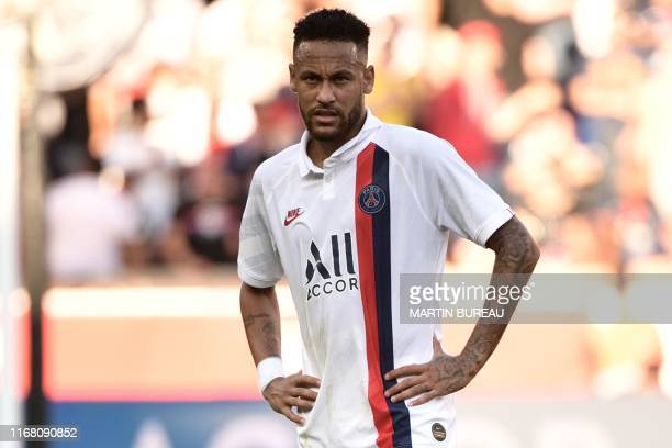 Paris SaintGermain's Brazilian forward Neymar reacts during the French L1 football match between Paris SaintGermain and Racing Club de Strasbourg...