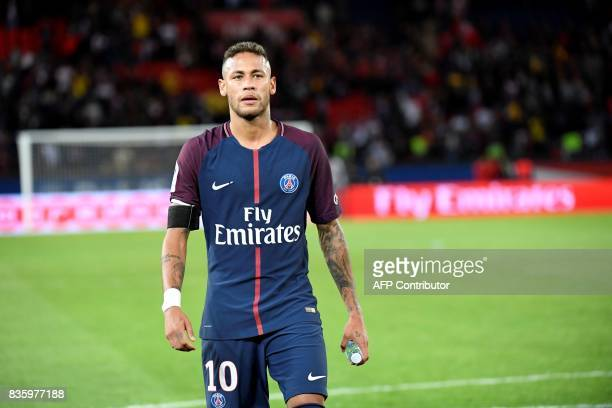 Paris SaintGermain's Brazilian forward Neymar reacts during the French L1 football match Paris SaintGermain vs Toulouse FC at the Parc des Princes...