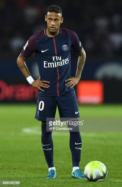 Paris SaintGermain's Brazilian forward Neymar reacts during the French Ligue 1 football match between Paris SaintGermain and SaintEtienne at the Parc...