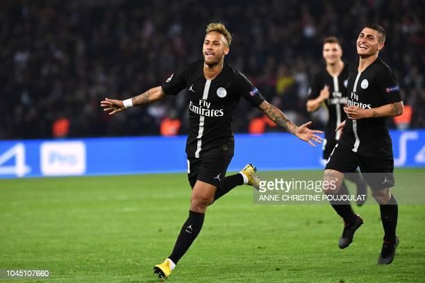 Paris SaintGermain's Brazilian forward Neymar reacts following his third goal during their UEFA Champions' League football match Paris Saint Germain...