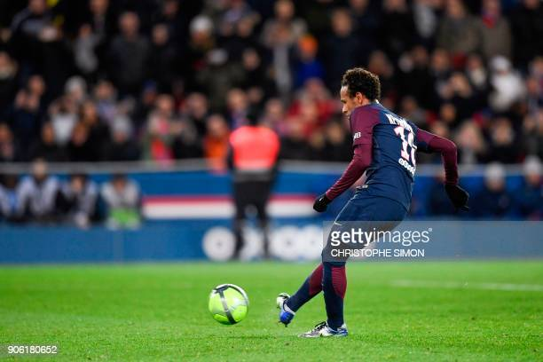 Paris SaintGermain's Brazilian forward Neymar readies to shoot a penalty shot scoring the team's eighth goal during the French L1 football match...
